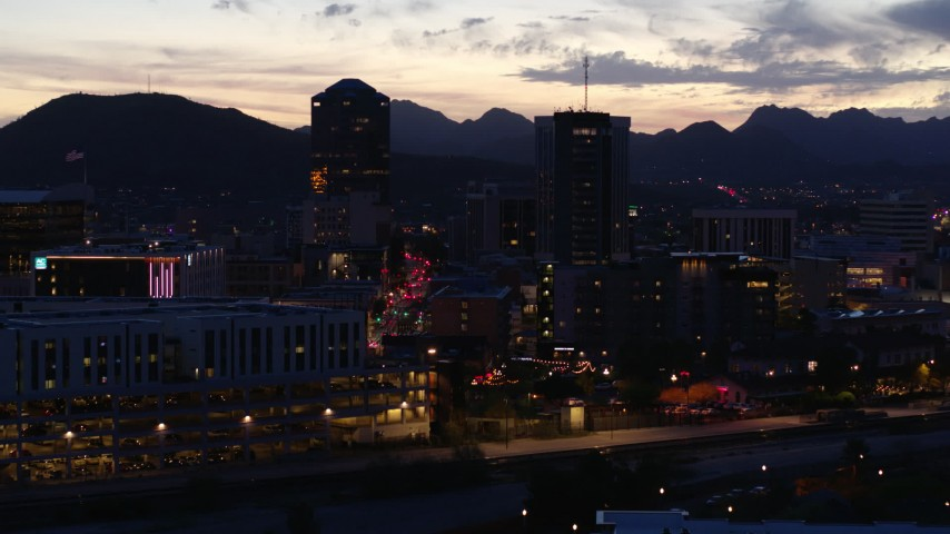 5.7K stock footage aerial video ascend and approach tall office towers and Congress Street at twilight, Downtown Tucson, Arizona Aerial Stock Footage | DX0002_147_030