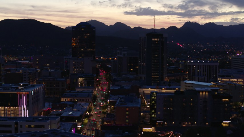 5.7K stock footage aerial video orbit tall office towers and Congress Street at twilight, Downtown Tucson, Arizona Aerial Stock Footage | DX0002_147_031