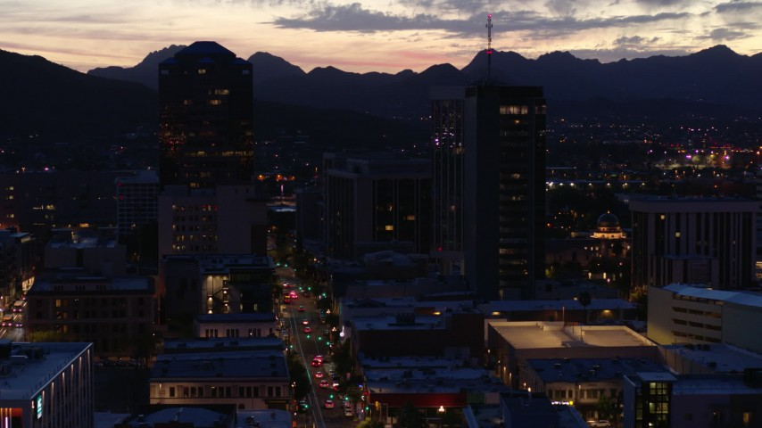 5.7K stock footage aerial video slow orbit tall office towers and Congress Street at twilight, Downtown Tucson, Arizona Aerial Stock Footage | DX0002_147_032