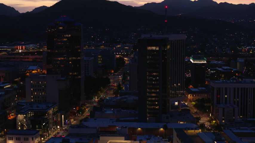 5.7K stock footage aerial video circling tall office towers and reveal Congress Street at twilight, Downtown Tucson, Arizona Aerial Stock Footage | DX0002_147_033