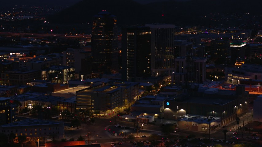 5.7K stock footage aerial video orbit three tall office towers at twilight, Downtown Tucson, Arizona Aerial Stock Footage | DX0002_147_034