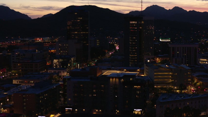 5.7K stock footage aerial video orbit two towering office buildings at twilight, Downtown Tucson, Arizona Aerial Stock Footage | DX0002_147_036