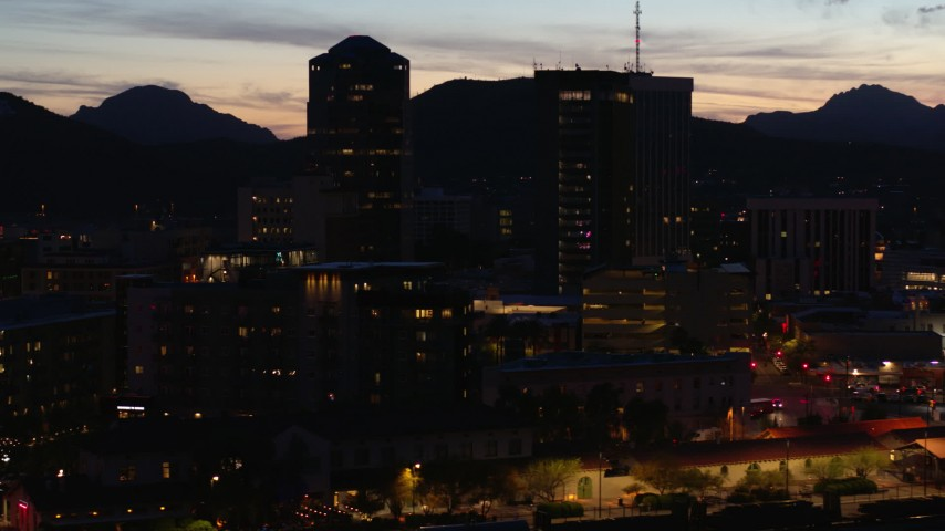 5.7K stock footage aerial video orbiting three towering office buildings at twilight, Downtown Tucson, Arizona Aerial Stock Footage | DX0002_147_037