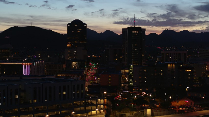 5.7K stock footage aerial video a reverse view of two towering office buildings at twilight, Downtown Tucson, Arizona Aerial Stock Footage | DX0002_147_038