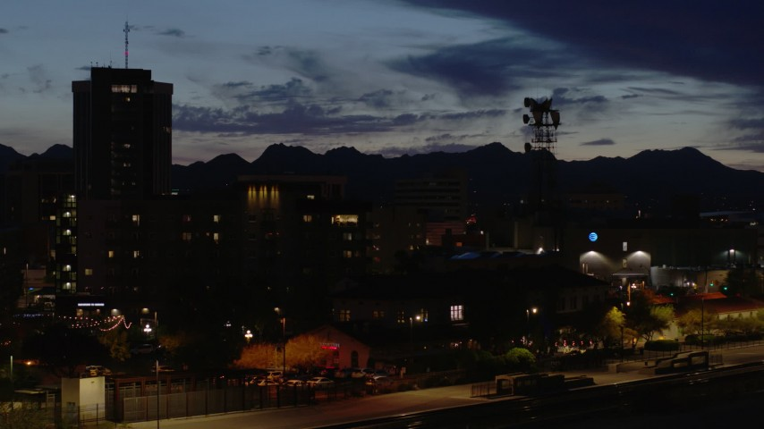 5.7K stock footage aerial video flyby tower and tall office buildings at twilight, Downtown Tucson, Arizona Aerial Stock Footage | DX0002_147_040