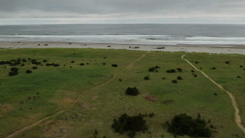 4K stock footage aerial video of flying by people on the beach in Long Beach, Washington Aerial Stock Footage | DX0002_148_006