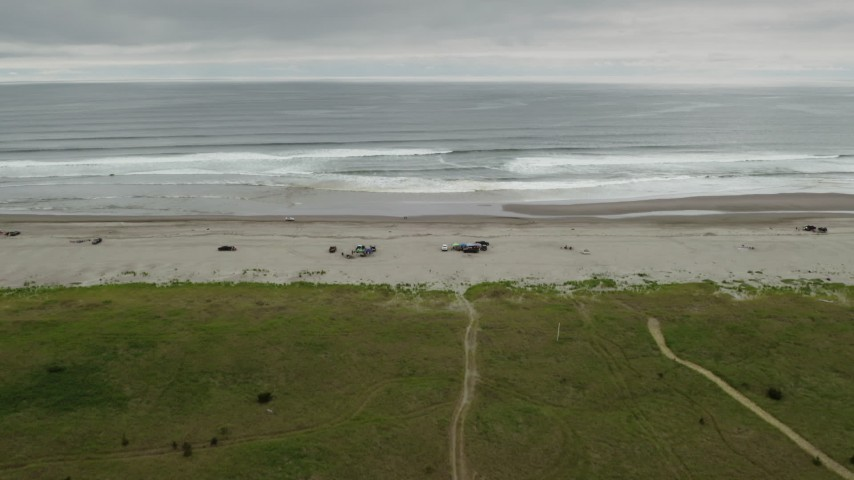 4K stock footage aerial video of approaching people on the beach and ocean in Long Beach, Washington Aerial Stock Footage | DX0002_148_007