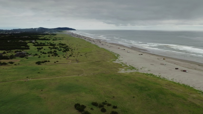 4K stock footage aerial video of a wide view of people on the beach in Long Beach, Washington Aerial Stock Footage | DX0002_148_008