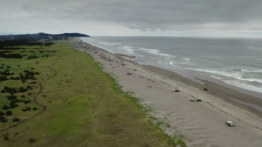 4K stock footage aerial video approach people on the beach in Long Beach, Washington Aerial Stock Footage | DX0002_148_010