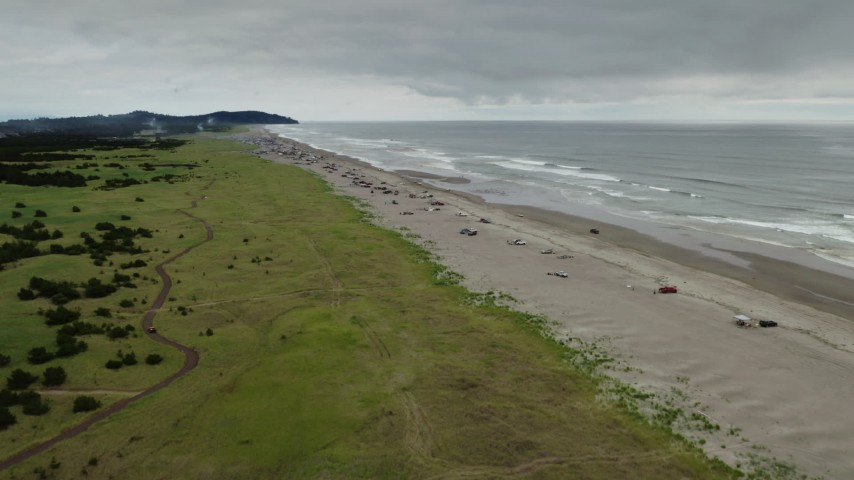 4K stock footage aerial video reverse view of people on the beach in Long Beach, Washington Aerial Stock Footage | DX0002_148_011