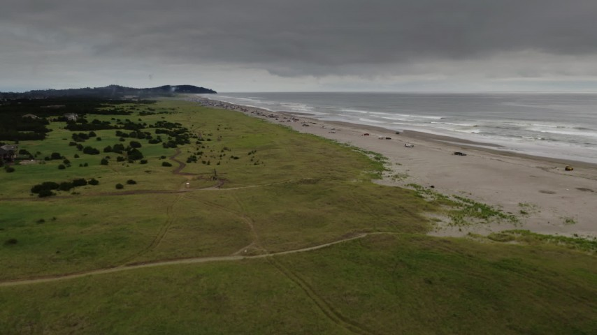 4K stock footage aerial video of people on the beach in Long Beach, Washington Aerial Stock Footage | DX0002_148_016