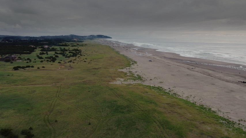 4K stock footage aerial video of approaching beach-goers near the ocean in Long Beach, Washington Aerial Stock Footage | DX0002_148_021