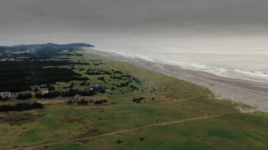 4K stock footage aerial video a wide view of beach and ocean waves at sunset in Long Beach, Washington Aerial Stock Footage | DX0002_148_027