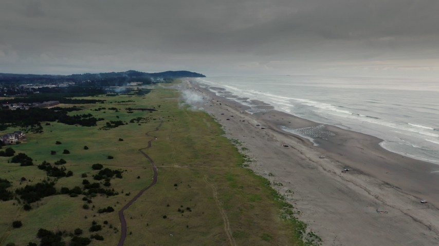 4K stock footage aerial video fly away from the beach at sunset in Long Beach, Washington Aerial Stock Footage | DX0002_148_033