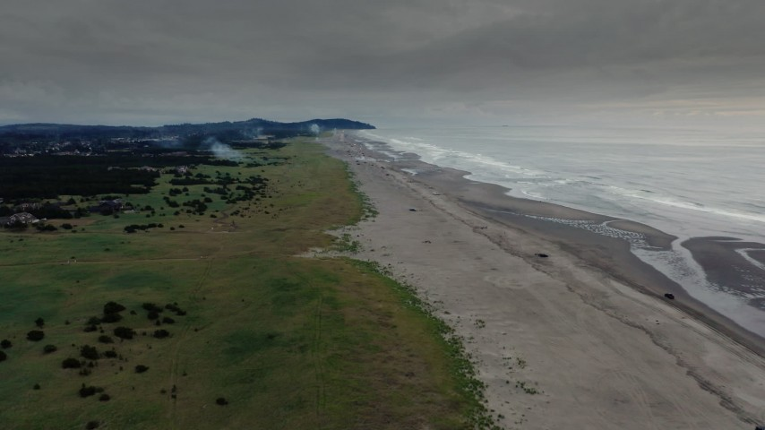 4K stock footage aerial video approach and flyby the beach as fireworks go off at sunset in Long Beach, Washington Aerial Stock Footage | DX0002_148_035