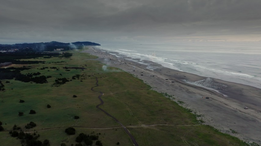 4K stock footage aerial video of the beach as fireworks go off at sunset in Long Beach, Washington Aerial Stock Footage | DX0002_148_037