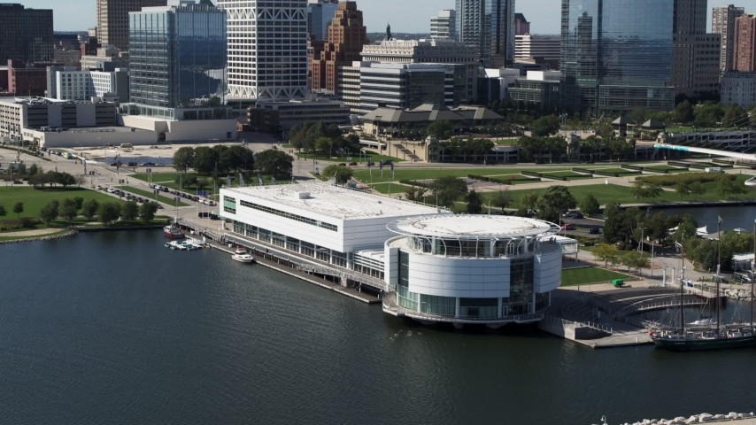 5.7K stock footage aerial video of descending near Discovery World museum in Downtown Milwaukee, Wisconsin Aerial Stock Footage | DX0002_149_011