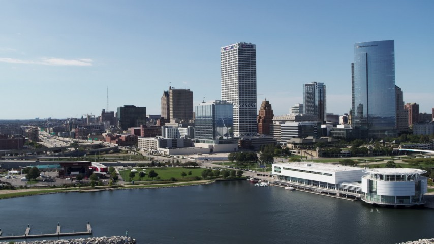 5.7K stock footage aerial video flying by the waterfront museum with a view of city buildings in Downtown Milwaukee, Wisconsin Aerial Stock Footage | DX0002_149_023