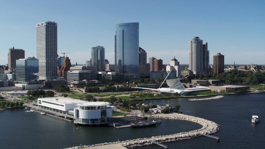 5.7K stock footage aerial video of flying around the waterfront museum with a view of the city in Downtown Milwaukee, Wisconsin Aerial Stock Footage | DX0002_149_026