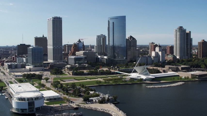 5.7K stock footage aerial video of tall skyscrapers seen from Discover World museum in Downtown Milwaukee, Wisconsin Aerial Stock Footage | DX0002_149_027