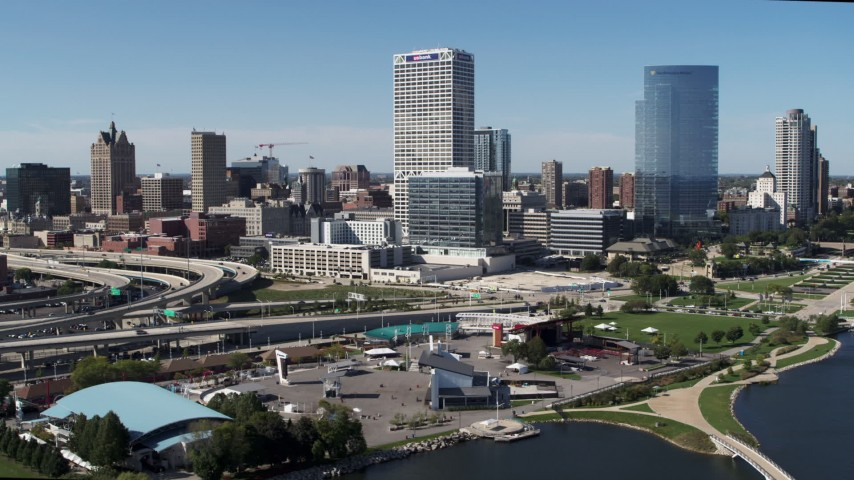 5.7K stock footage aerial video of tall skyscrapers seen while flying near an outdoor stage in Downtown Milwaukee, Wisconsin Aerial Stock Footage | DX0002_149_029