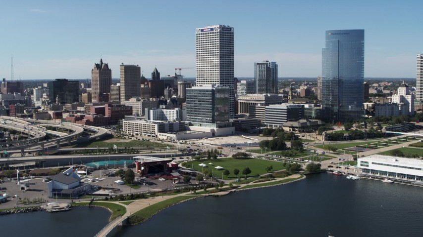 5.7K stock footage aerial video of a view of tall skyscrapers seen from Milwaukee Bay, Downtown Milwaukee, Wisconsin Aerial Stock Footage | DX0002_149_032