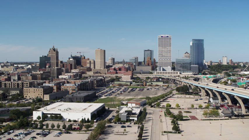 5.7K stock footage aerial video of flying by and away from the city's skyline in Downtown Milwaukee, Wisconsin Aerial Stock Footage | DX0002_149_038