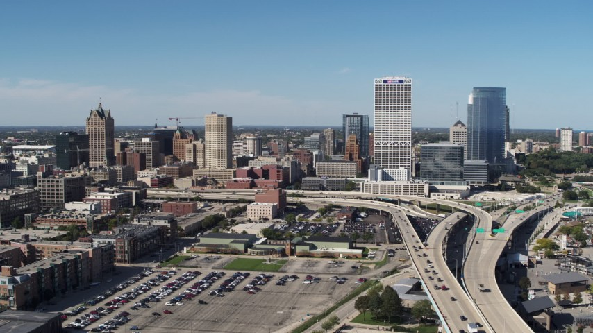 5.7K stock footage aerial video of a reverse view of the city's skyline and I-794 in Downtown Milwaukee, Wisconsin Aerial Stock Footage | DX0002_149_042