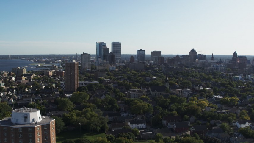 5.7K stock footage aerial video of ascending for a wide view of the city's skyline in Downtown Milwaukee, Wisconsin Aerial Stock Footage | DX0002_150_002