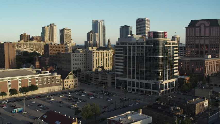 5.7K stock footage aerial video of flying away from a dormitory complex at sunset in Downtown Milwaukee, Wisconsin Aerial Stock Footage | DX0002_150_011