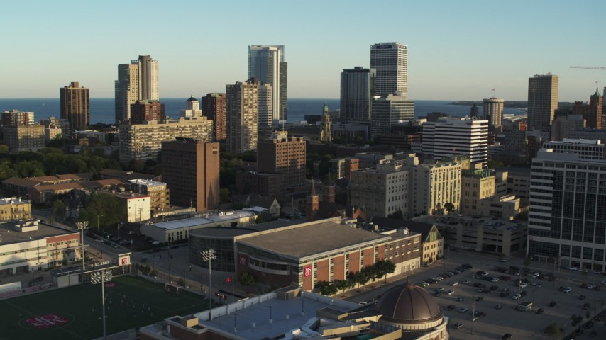 5.7K stock footage aerial video of ascending for a view of the skyline at sunset in Downtown Milwaukee, Wisconsin Aerial Stock Footage | DX0002_150_013