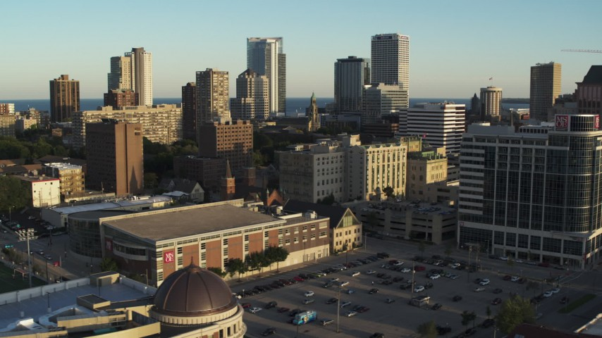 5.7K stock footage aerial video of a view of the skyline while flying by dormitory building at sunset in Downtown Milwaukee, Wisconsin Aerial Stock Footage | DX0002_150_015