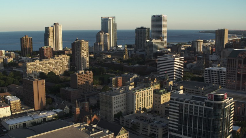 5.7K stock footage aerial video of flying by the skyline seen from college campus at sunset in Downtown Milwaukee, Wisconsin Aerial Stock Footage | DX0002_150_017
