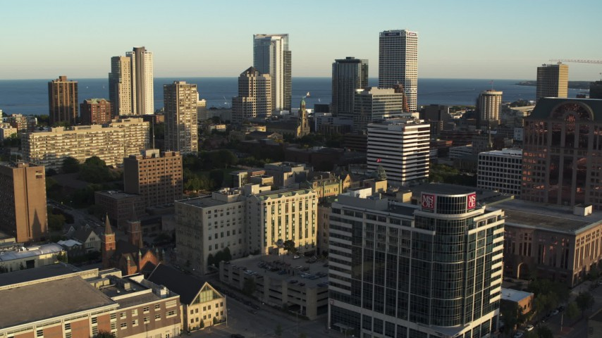 5.7K stock footage aerial video of flying by the skyline seen from college campus at sunset in Downtown Milwaukee, Wisconsin Aerial Stock Footage | DX0002_150_018