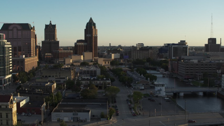 5.7K stock footage aerial video tall office tower by the Milwaukee River at sunset, Downtown Milwaukee, Wisconsin Aerial Stock Footage | DX0002_150_025