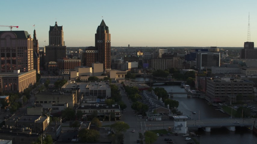 5.7K stock footage aerial video view of city buildings, tall office tower by the Milwaukee River at sunset, Downtown Milwaukee, Wisconsin Aerial Stock Footage | DX0002_150_028