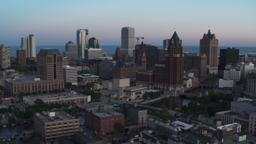 5.7K stock footage aerial video city buildings and skyscrapers behind office tower at twilight, Downtown Milwaukee, Wisconsin Aerial Stock Footage | DX0002_150_032