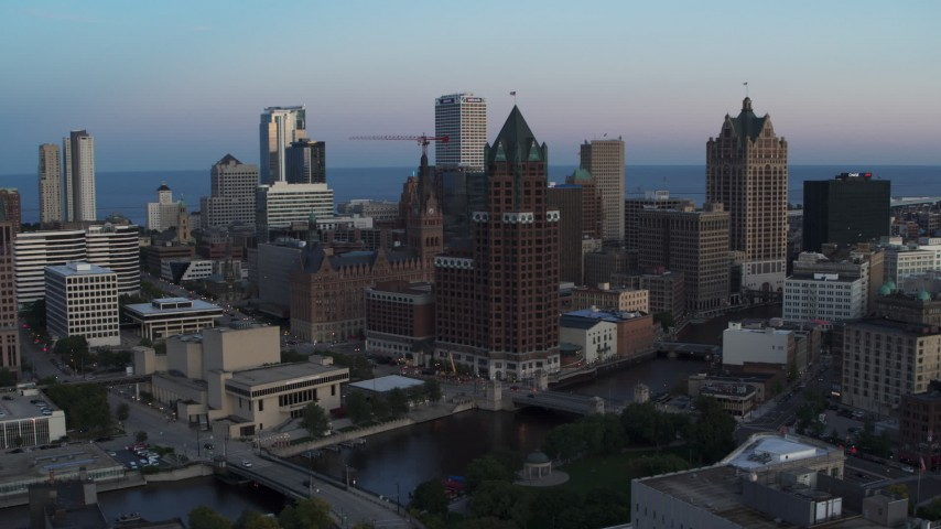 5.7K stock footage aerial video of a riverfront office tower at twilight, Downtown Milwaukee, Wisconsin Aerial Stock Footage | DX0002_150_033