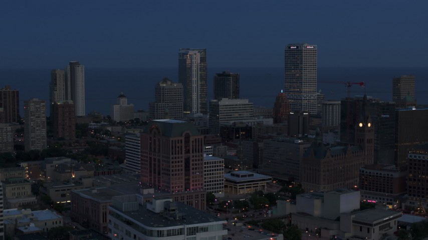 5.7K stock footage aerial video a view of across the city of tall skyscrapers, Downtown Milwaukee, Wisconsin at twilight Aerial Stock Footage | DX0002_150_038