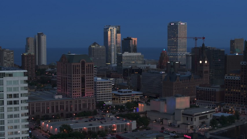 5.7K stock footage aerial video a view of tall skyscrapers, reveal apartment tower, Downtown Milwaukee, Wisconsin at twilight Aerial Stock Footage | DX0002_150_039