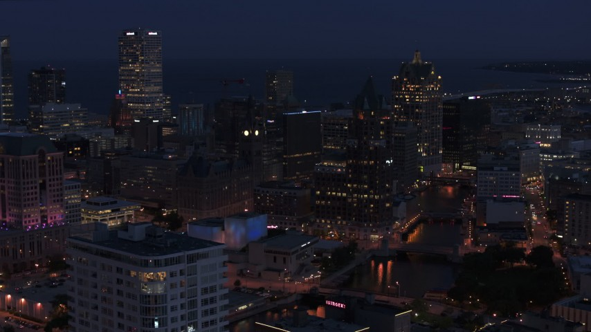 5.7K stock footage aerial video a stationary view of skyscrapers at night, Downtown Milwaukee, Wisconsin Aerial Stock Footage | DX0002_151_005