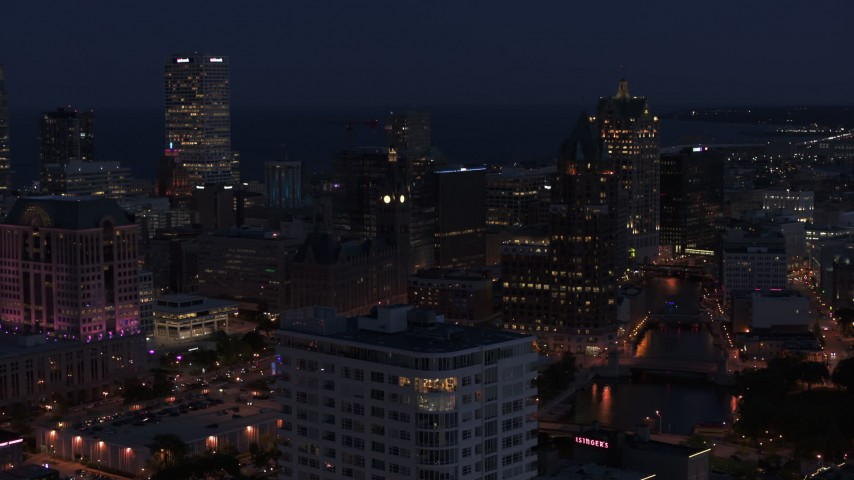 5.7K stock footage aerial video of skyscrapers seen while descending by apartment high-rise at night, Downtown Milwaukee, Wisconsin Aerial Stock Footage | DX0002_151_006