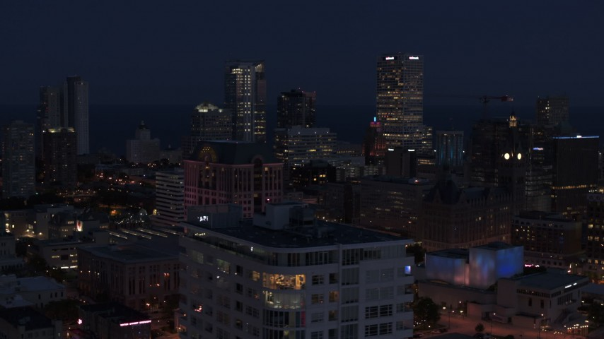 5.7K stock footage aerial video of skyscrapers at night, seen while passing The Moderne, Downtown Milwaukee, Wisconsin Aerial Stock Footage | DX0002_151_007
