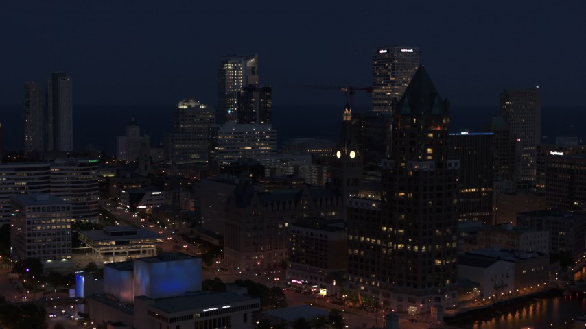 5.7K stock footage aerial video of skyscrapers at night, seen while passing Milwaukee Center, Downtown Milwaukee, Wisconsin Aerial Stock Footage | DX0002_151_008