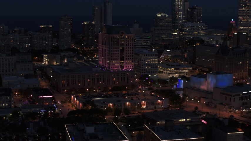 5.7K stock footage aerial video orbit a downtown office building at night, Downtown Milwaukee, Wisconsin Aerial Stock Footage | DX0002_151_009