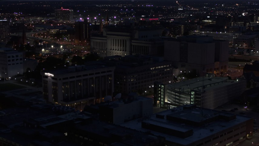 5.7K stock footage aerial video of flying away from the Milwaukee County Circuit Court at night, Milwaukee, Wisconsin Aerial Stock Footage | DX0002_151_011
