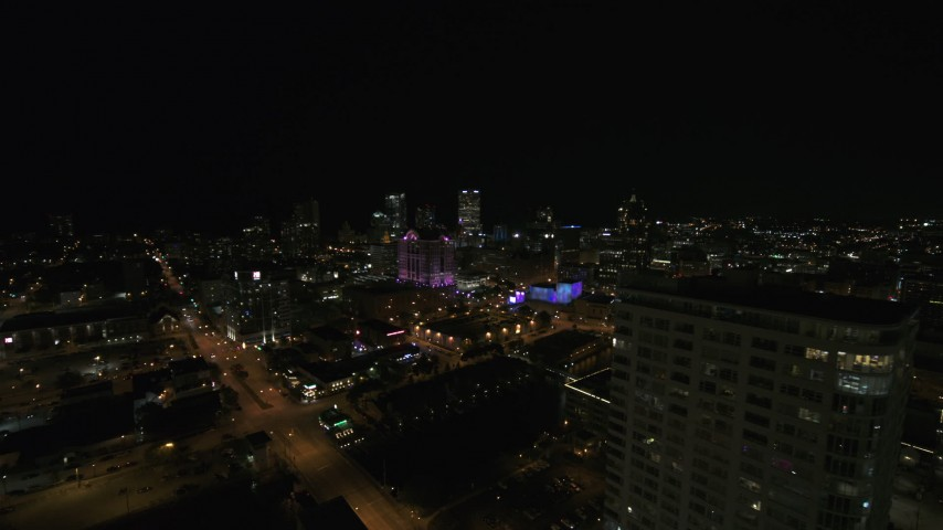 5.7K stock footage aerial video fly away from skyline to reveal an apartment high-rise at night, Downtown Milwaukee, Wisconsin Aerial Stock Footage   DX0002_151_018
