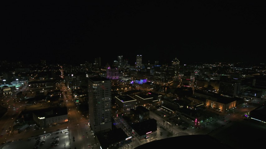 5.7K stock footage aerial video a view across downtown toward city skyline at night, Downtown Milwaukee, Wisconsin Aerial Stock Footage | DX0002_151_019