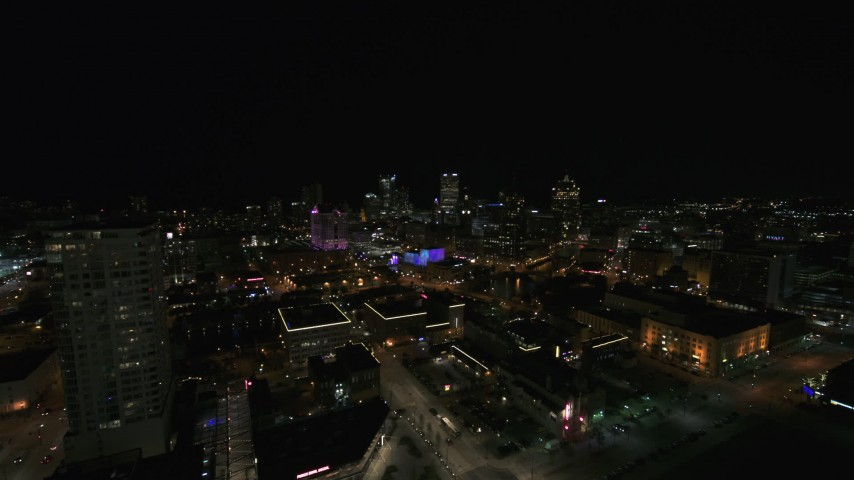 5.7K stock footage aerial video reverse view of the city skyline and apartment high-rise at night, Downtown Milwaukee, Wisconsin Aerial Stock Footage | DX0002_151_020
