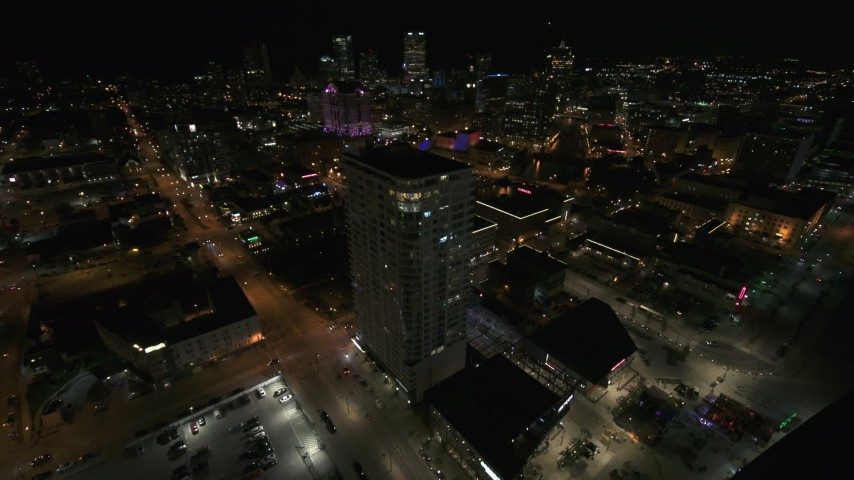 5.7K stock footage aerial video approach and orbit an apartment high-rise at night, Downtown Milwaukee, Wisconsin Aerial Stock Footage | DX0002_151_023